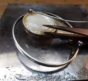 Removing a glued gem
